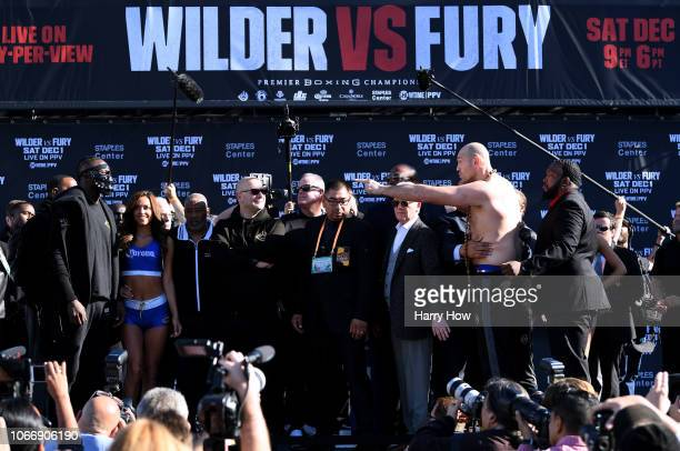 Tyson Fury taunts Deontay Wilder during the Deontay Wilder v Tyson Fury weigh-in at Los Angeles Convention Center on November 30, 2018 in Los...