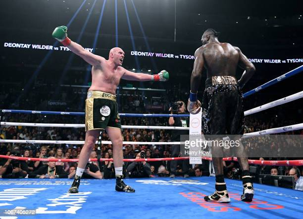 Tyson Fury taunts Deontay Wilder in the ninth round fighting to a draw during the WBC Heavyweight Championship at Staples Center on December 1 2018...