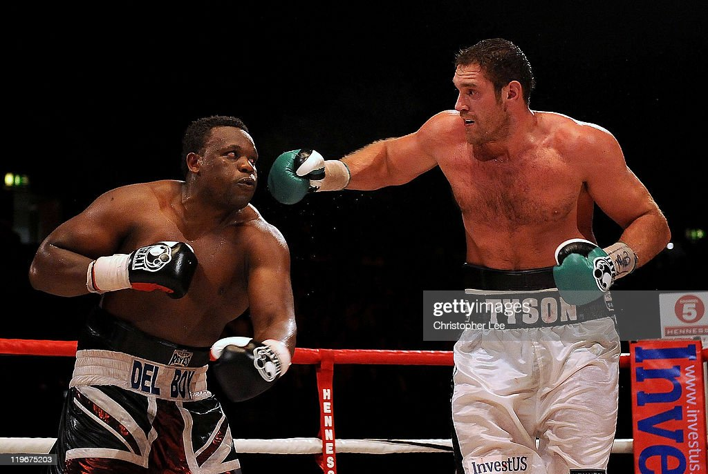 Tyson Fury (R) throws a punch at Dereck Chisora during the British & Commonwealth Heavyweight Title Fight between Dereck Chisora and Tyson Fury at Wembley Arena on July 23, 2011 in London, England.