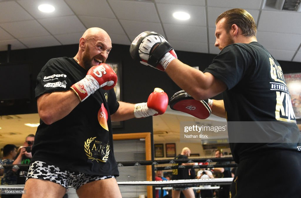 Tyson Fury trains during a media workout at Hatton Health & Fitness on July 31, 2018 in Hyde, England.