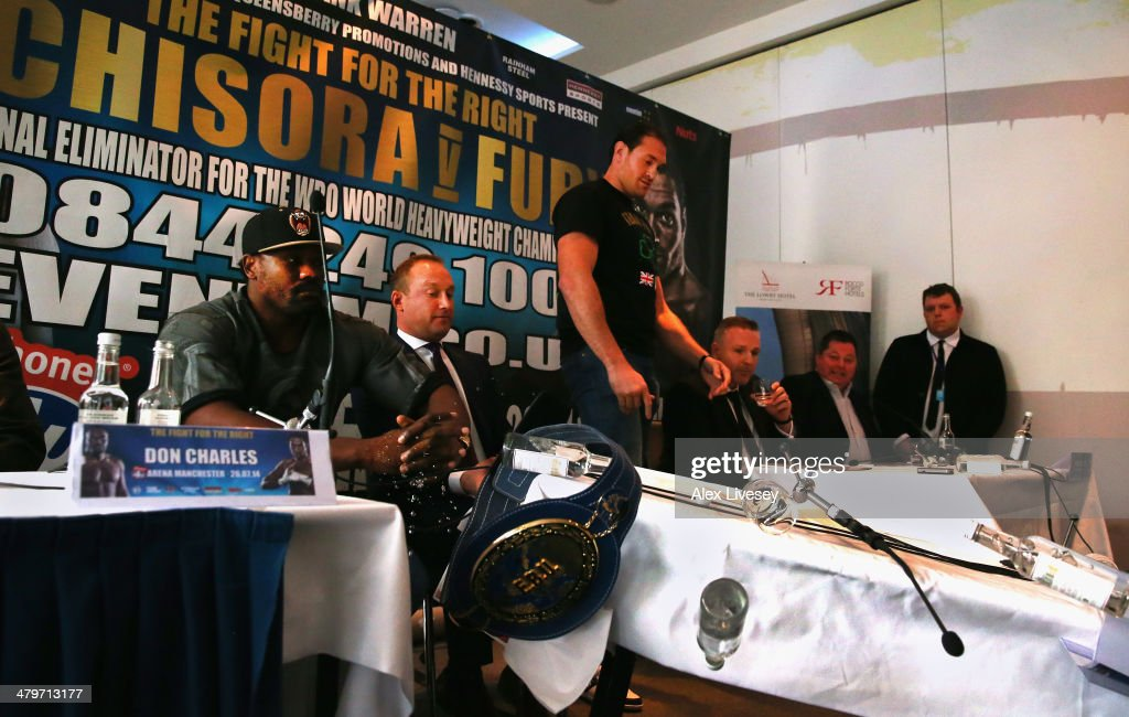 Tyson Fury turns over the top table and walks out of the Dereck Chisora And Tyson Fury Press Conference held at the Lowry Hotel on March 20, 2014 in Manchester, England.