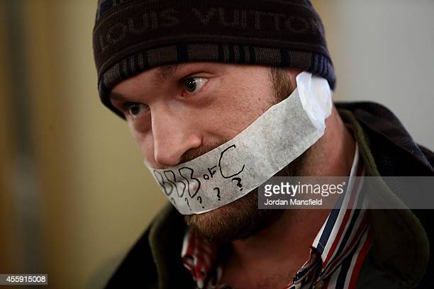 Tyson Fury with tape over his mouth after refusing to speak during the Dereck Chisora And Tyson Fury Press Conference at The Grosvenor House on...
