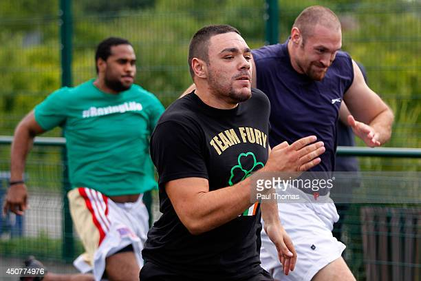 Tyson Fury Young Fury and Eddie Chambers run during the Tyson Fury Media Session at the Eddie Davies Football Academy on June 17 2014 in Bolton...