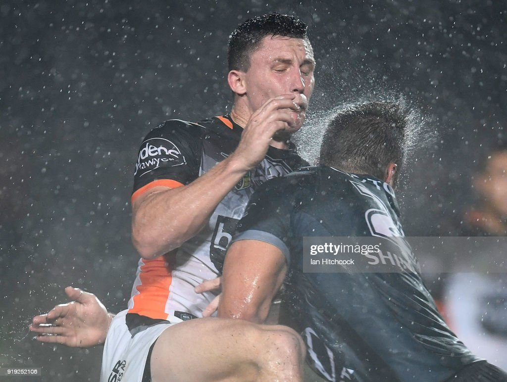 Tyson Gamble of the Tigers is hit by Sam Hoare of the Cowboys during the NRL trial match between the North Queensland Cowboys and the Wests Tigers at Barlow Park on February 17, 2018 in Cairns, Australia.