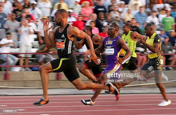 Tyson Gay competes in the finals of the men's 100 meter dash on the second day of the AT&T USA Outdoor Track and Field Championships at IU Michael A....