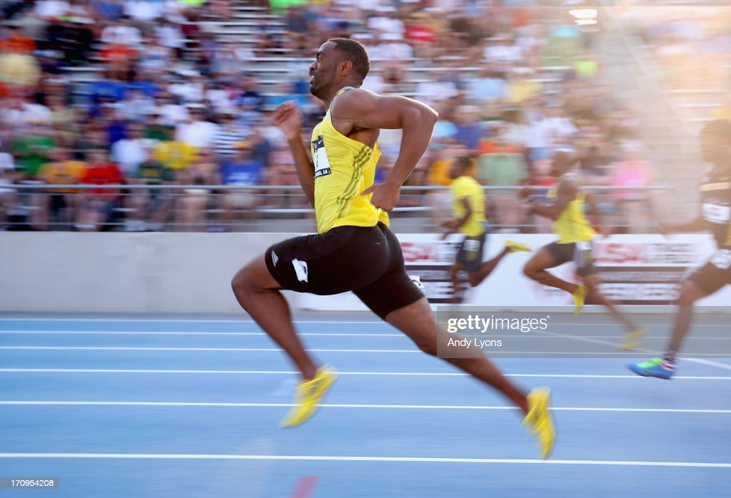 Tyson Gay competes in the Mens 100 Meter on day one of the 2013 USA Outdoor Track & Field Championships at Drake Stadium on June 20, 2013 in Des Moines, Iowa.