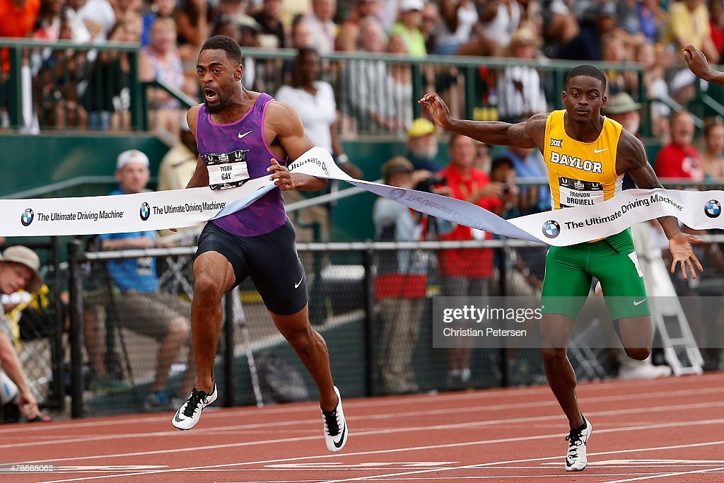 Tyson Gay (L) crosses the finish line ahead of Trayvon Bromell (R) to win the Men's 100 Meter Dash Final during day two of the 2015 USA Outdoor Track & Field Championships at Hayward Field on June 26, 2015 in Eugene, Oregon.
