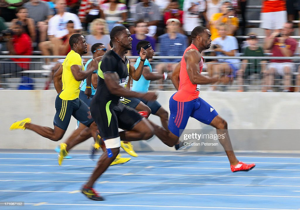 Tyson Gay (R) leads the pack en route to winning the Men's 100 Meter Dash final on day two of the 2013 USA Outdoor Track & Field Championships at Drake Stadium on June 21, 2013 in Des Moines, Iowa.