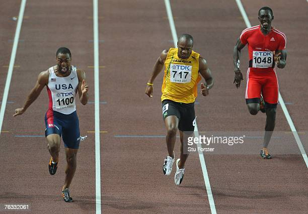 Tyson Gay of the United States of America, Asafa Powell of Jamaica and Marc Burns of Trinidad and Tobago compete in the Men's 100m final on day two...