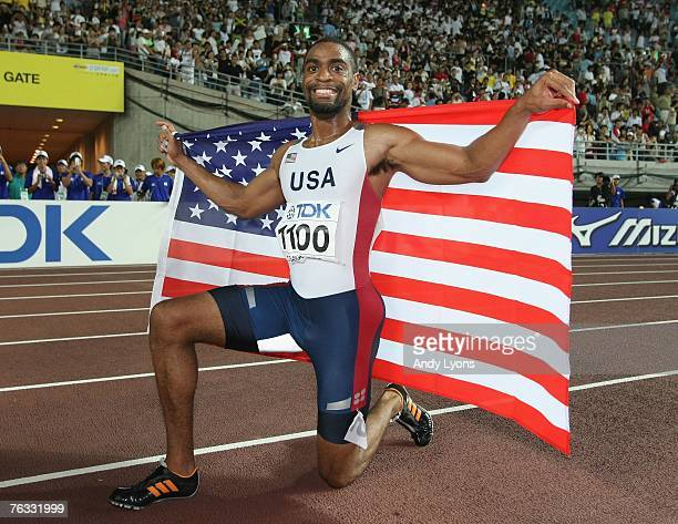 Tyson Gay of the United States of America celebrates winning the Men's 100m final on day two of the 11th IAAF World Athletics Championships on August...