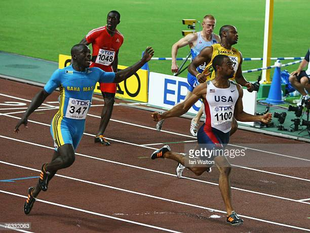 Tyson Gay of the United States of America comes in ahead of second placed Derrick Atkins of the Bahamas to win the Men's 100m final on day two of the...