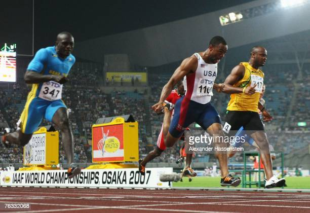 Tyson Gay of the United States of America comes in ahead of second placed Derrick Atkins of the Bahamas and third placed Asafa Powell of Jamaica to...