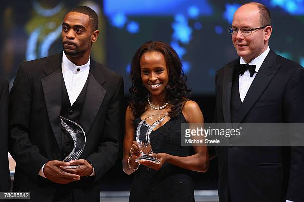 Tyson Gay of the USA and Meseret Defar of Ethiopia pose with HH Prince Albert ll of Monaco after being named Athletes of the Year during the IAAF...