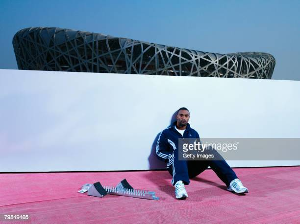 Tyson Gay of the USA poses in front of the National Stadium on February 4 2008 in Beijing China