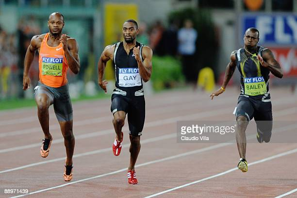 Tyson Gay of United States competes ahead of Asafa Powell of Jamaica and Daniel Bailey of Antigua and Barbuda in the men's 100 metres during the IAAF...