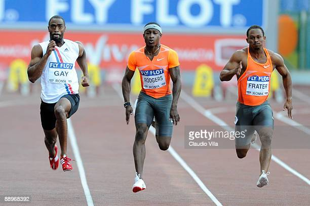 Tyson Gay of United States, Michael Rodgers of United States and Michael Frater of Jamaica competes in the men's 100 metres heat during the IAAF...