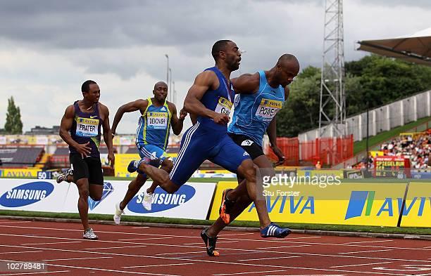Tyson Gay of USA beats Asafa Powell of Jamaica to win the mens 100 metres final during the Aviva British Grand Prix at Gateshead International...