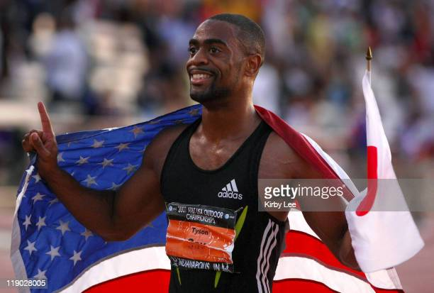 Tyson Gay poses with an American flag after winning the 100 meters in 9.84 in the USA Track & Field Championships at Carroll Stadium in Indianapolis,...