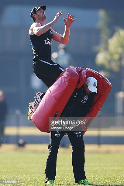 Tyson Goldsack jumps for the ball during a Collingwood Magpies AFL training session at Westpac Centre on August 15 2014 in Melbourne Australia