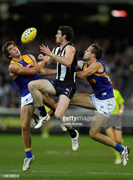 Tyson Goldsack of the Magpies and Andrew Gaff of the Eagles contest for a mark during the round 13 AFL match between the Collingwood Magpies and the...