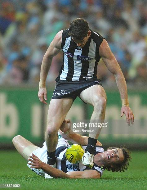 Tyson Goldsack of the Magpies and Josh Walker of the Cats compete for the ball during the AFL Round 16 game between the Geelong Cats and the...