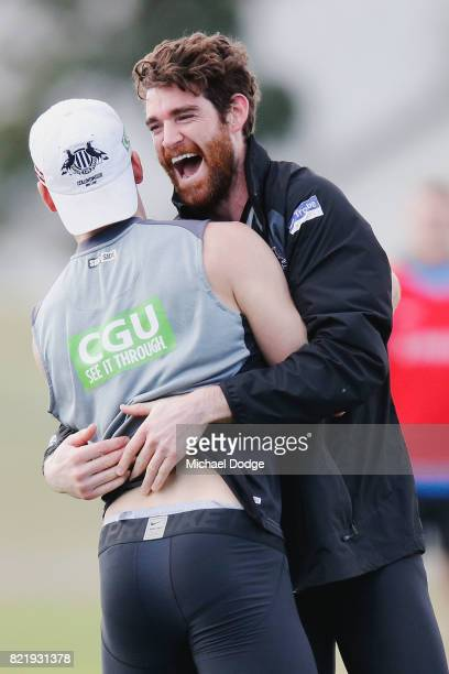 Tyson Goldsack of the Magpies celebrates a soccer goal with Jackson Ramsay during a Collingwood Magpies AFL media opportunity at the Holden Centre on...