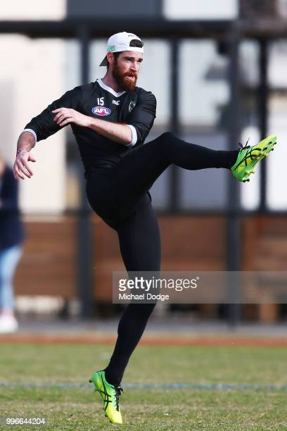 Tyson Goldsack of the Magpies coming back from a knee reconstruction kicks the ball during a Collingwood Magpies AFL press conference at the Holden...