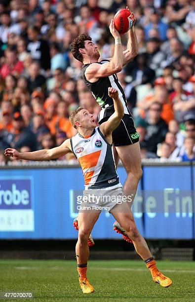 Tyson Goldsack of the Magpies marks over the top of Devon Smith of the Giants during the round 11 AFL match between the Collingwood Magpies and the...