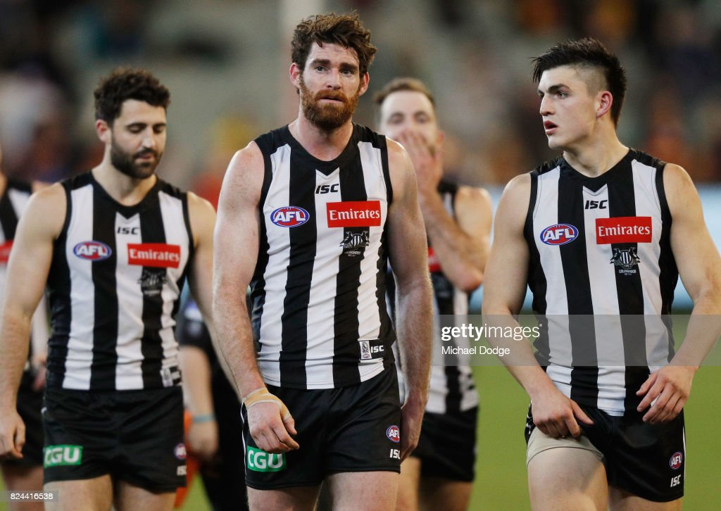 Tyson Goldsack of the Magpies walks off after a draw during the round 19 AFL match between the Collingwood Magpies and the Adelaide Crows at Melbourne Cricket Ground on July 30, 2017 in Melbourne, Australia.