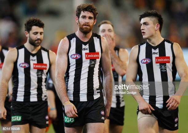 Tyson Goldsack of the Magpies walks off after a draw during the round 19 AFL match between the Collingwood Magpies and the Adelaide Crows at...