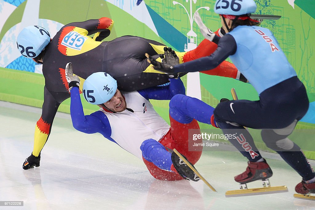 Tyson Heung of Germany crashes with Thibaut Fauconnet of France as Apolo Anton Ohno of the United States looks to pass in the Men's 500m Short Track Speed Skating Quarter-Finals on day 15 of the 2010 Vancouver Winter Olympics at Pacific Coliseum on February 26, 2010 in Vancouver, Canada.