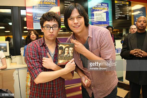 Tyson Houseman and Chaske Spencer hand out New Moon DVD's at the The Twilight Saga New Moon DVD release at Blockbuster Brookhaven on March 19 2010 in...