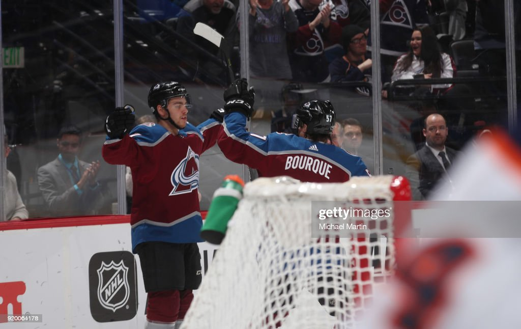 Tyson Jost #17 and Gabriel Bourque #57 of the Colorado Avalanche celebrate a goal against the Edmonton Oilers at the Pepsi Center on February 18, 2018 in Denver, Colorado.