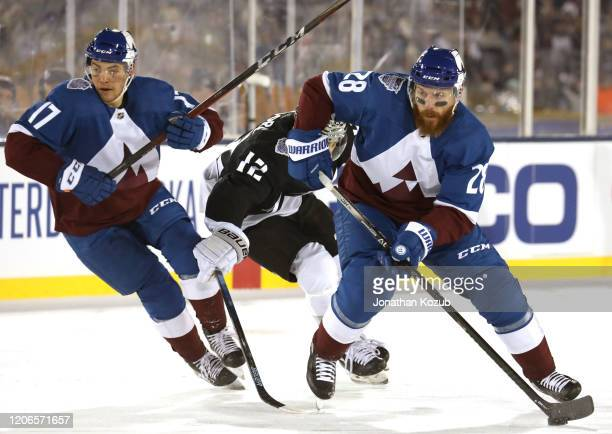Tyson Jost and Ian Cole of the Colorado Avalanche skate up ice during the third period of the 2020 NHL Stadium Series game between the Los Angeles...