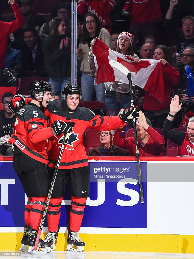 Tyson Jost #17 of Team Canada celebrates his goal with teammate Thomas Chabot #5 during the IIHF exhibition game against Team Finland at the Bell Centre on December 19, 2016 in Montreal, Quebec, Canada.