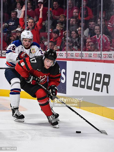 Tyson Jost of Team Canada skates the puck against Charlie McAvoy of Team United States during the 2017 IIHF World Junior Championship gold medal game...