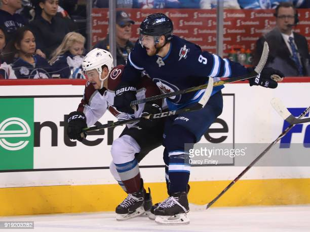 Tyson Jost of the Colorado Avalanche and Andrew Copp of the Winnipeg Jets follow the play down the ice during third period action at the Bell MTS...