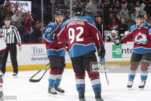 Tyson Jost of the Colorado Avalanche celebrates after scoring a goal against the Arizona Coyotes with teammates Gabriel Landeskog and Tyson Barrie at...