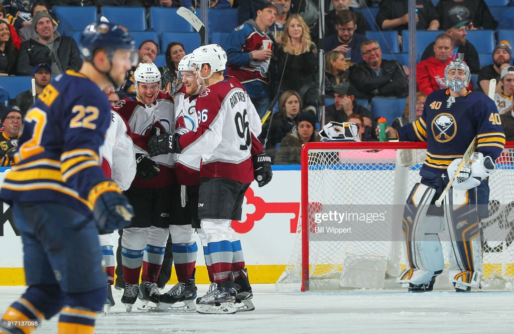 Tyson Jost #17 of the Colorado Avalanche celebrates his third period goal during an NHL game as Johan Larsson #22 and Robin Lehner #40 of the Buffalo Sabres react on February 11, 2018 at KeyBank Center in Buffalo, New York. Colorado won, 5-4.