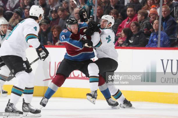 Tyson Jost of the Colorado Avalanche fights for position against Dylan DeMelo of the San Jose Sharks at the Pepsi Center on February 6 2018 in Denver...