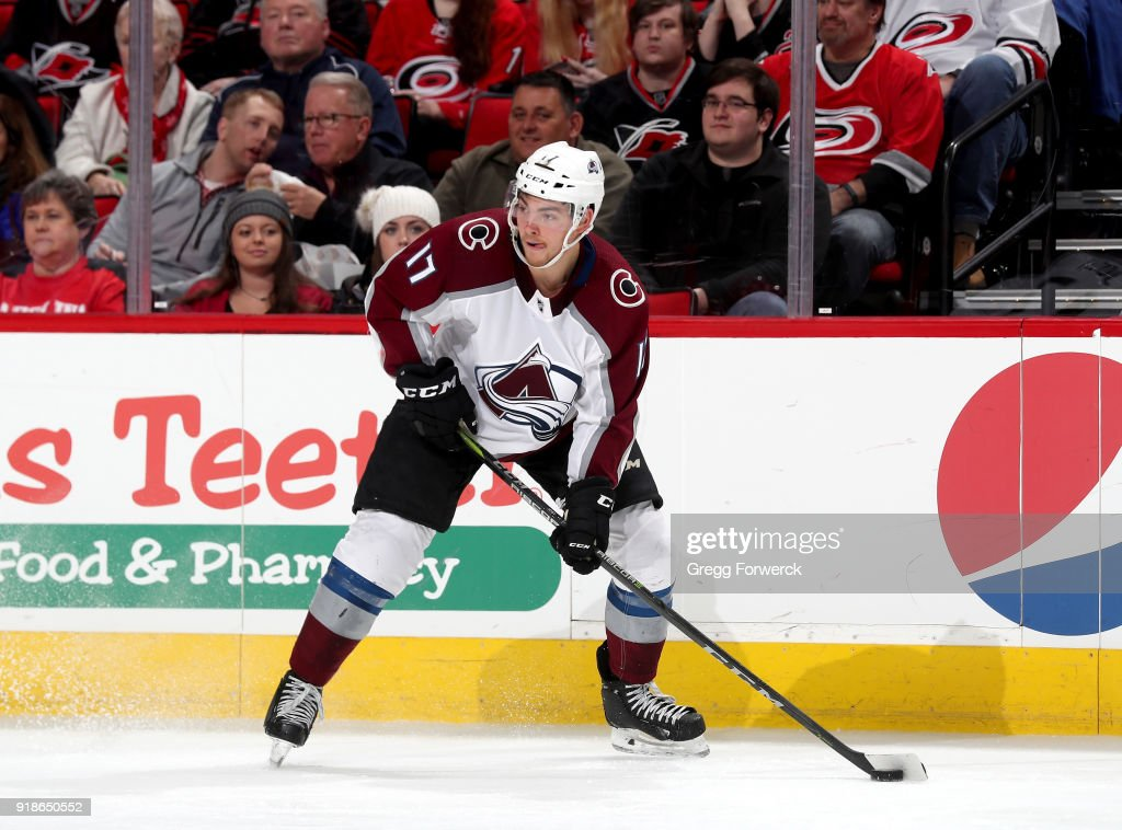 Tyson Jost #17 of the Colorado Avalanche looks to pass the puck during an NHL game against the Carolina Hurricanes on February 10, 2018 at PNC Arena in Raleigh, North Carolina.