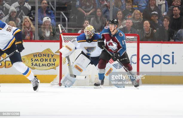 Tyson Jost of the Colorado Avalanche sets up in front of goaltender Jake Allennof the St Louis Blues at the Pepsi Center on April 7 2018 in Denver...