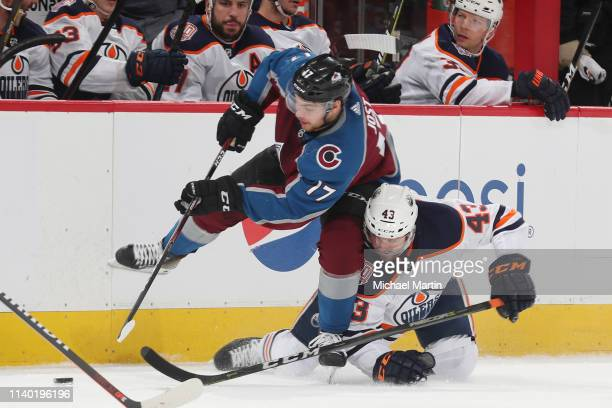 Tyson Jost of the Colorado Avalanche skates against Josh Currie of the Edmonton Oilers at the Pepsi Center on April 2 2019 in Denver Colorado The...