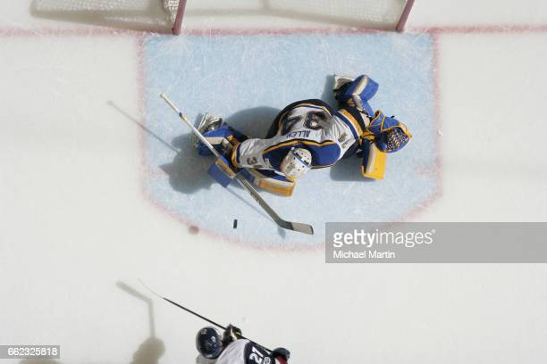 Tyson Jost of the Colorado Avalanche takes a shot against goaltender Jake Allen of the St Louis Blues during a shootout at the Pepsi Center on March...