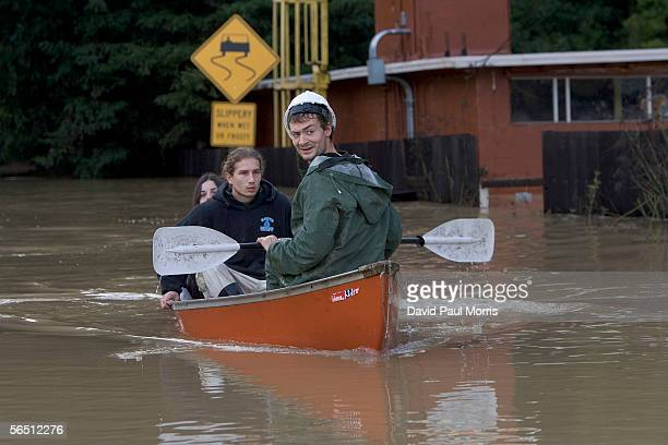 Tyson McClain ferries Sarah Tucker and David Kasper back and forth to their homes off Drake road from a flood on January 2 2006 in Guerneville...