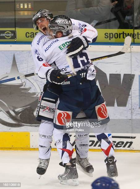Tyson Mulock of Berlin celebrates with his team mate Travis James Mulock after scoring his team's third goal during game six of the DEL playoffs...