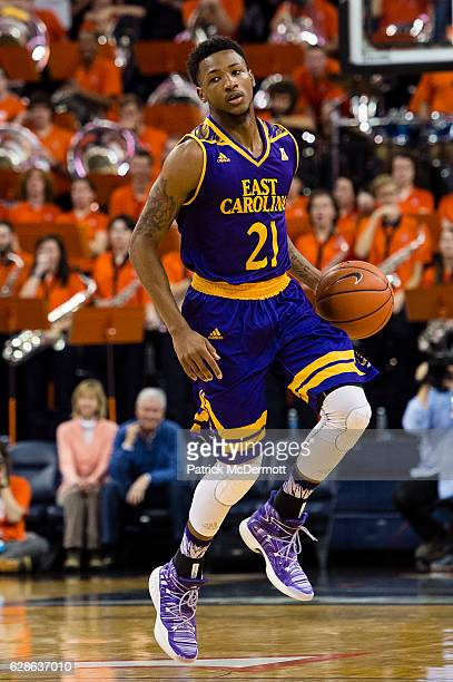 J Tyson of the East Carolina Pirates dribbles the ball against the Virginia Cavaliers in the first half during a game at John Paul Jones Arena on...