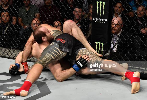 Tyson Pedro of Australia submits Saparbek Safarov of Russiain their light heavyweight bout during the UFC 221 event at Perth Arena on February 11...