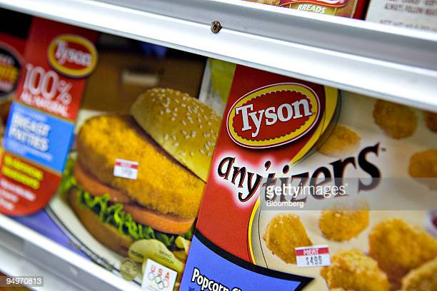 Tyson popcorn chicken right and chicken patties sit on display in a supermarket in New York US on Monday Aug 3 2009 Tyson Foods Inc the world's...