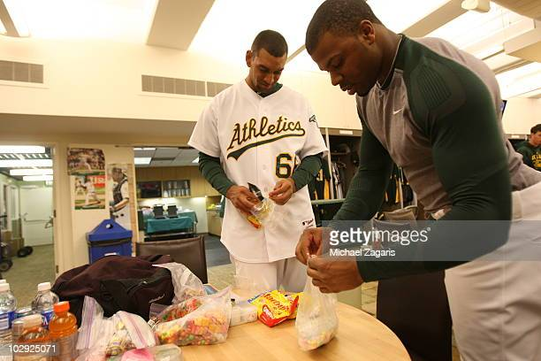 Tyson Ross and Rajai Davis of the Oakland Athletics load up on candy in the clubhouse prior to the game against the New York Yankees at the...